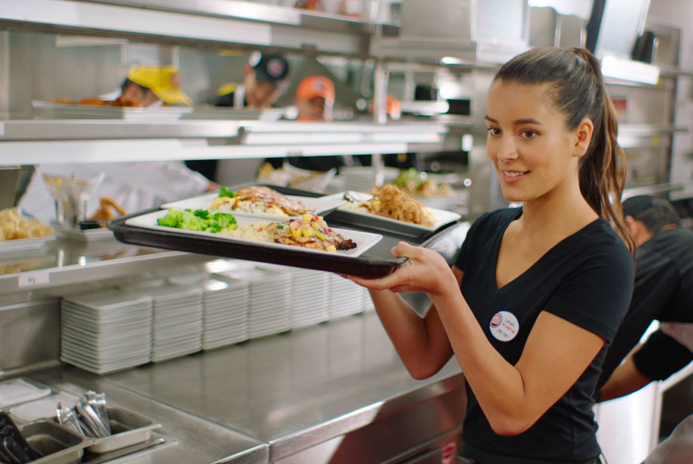 Female server with tray of food