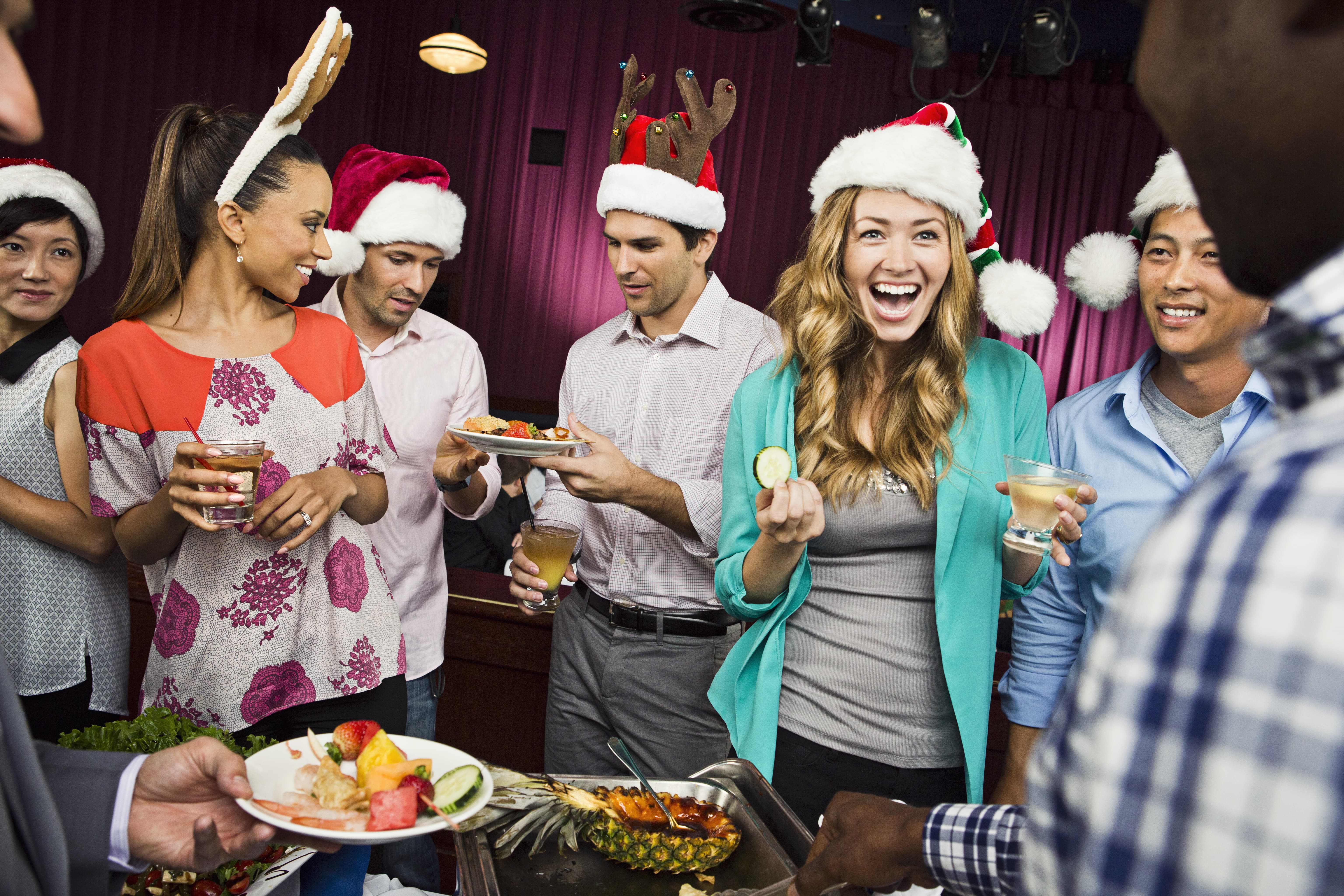 Holiday party celebrations in Santa hats