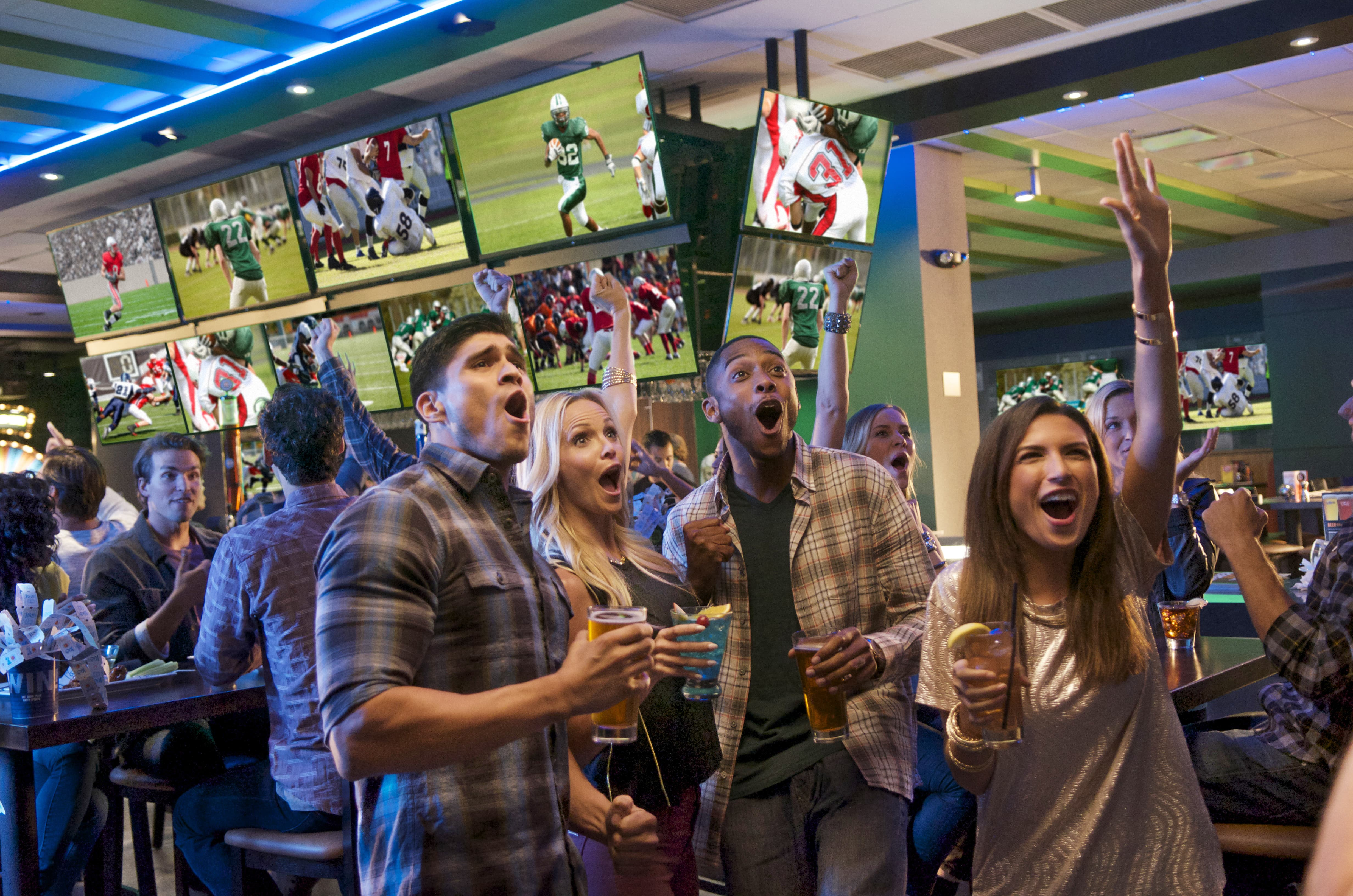 Friends Reacting in Sports Bar