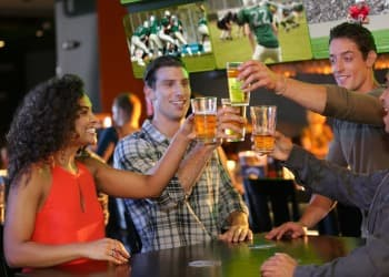 Friends Cheers in Sports Bar